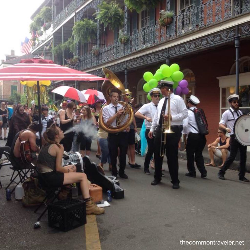 band walking through New Orleans' French Quarter