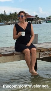 Belize woman on dock in Belize with coffee