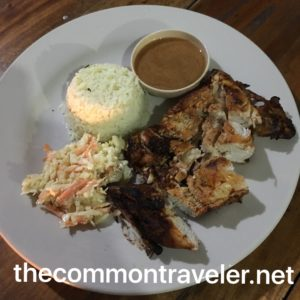 The Best Restaurants in San Pedro Belize featured by top travel blog, The Common Traveler: Robin's Kitchen jerk chicken