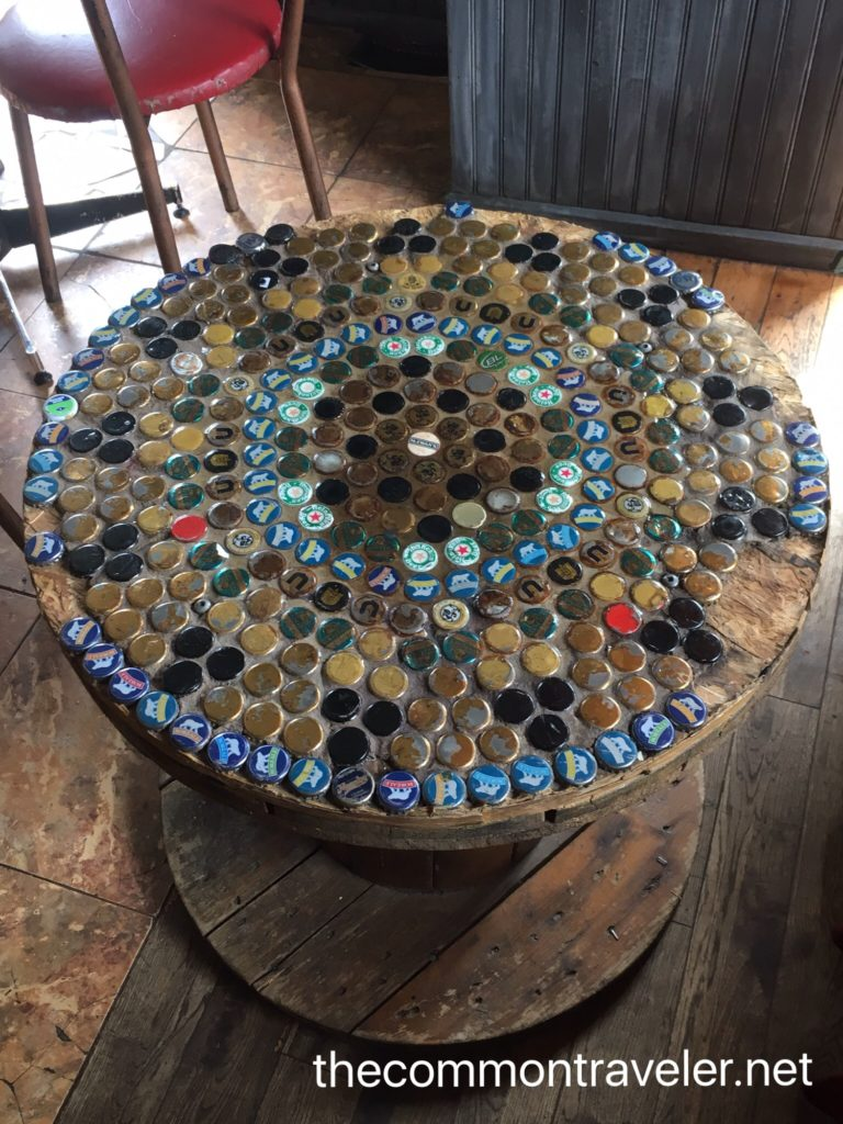 bottle cap table at Le Baril Rouland