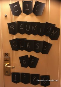 Top 5 Reasons to Go on a Reunion Cruise featured by top travel blog, The Common Traveler: cruise door with reunion sign