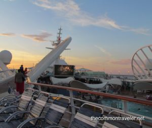 Top 5 Reasons to Go on a Reunion Cruise featured by top travel blog, The Common Traveler: reunion movie screen on ship deck