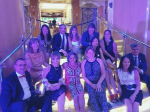 Top 5 Reasons to Go on a Reunion Cruise featured by top travel blog, The Common Traveler: reunion group of people on stairs in cruise ship
