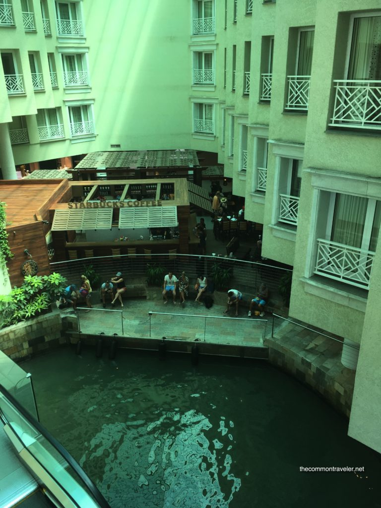 Visiting Flamingo Beach in Aruba, tips featured by top affordable travel blog, The Common Traveler: view of indoor marina at Renaissance Marina Hotel in Aruba