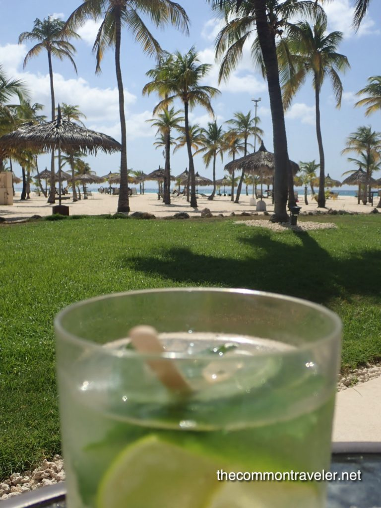 mojito with Manchebo Beach in the background