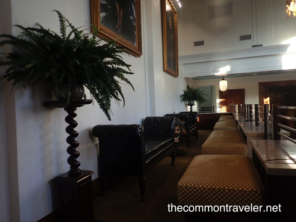 O'Neil Hotel lobby seats using old bank teller areas