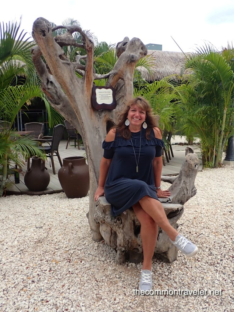 woman sitting on wood tree stump chair