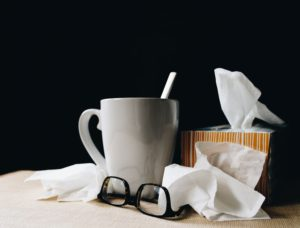 Sick While Traveling tissues with cup and glasses