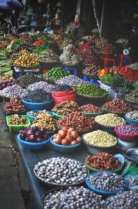 Sick While Traveling market of vegetables and fruits
