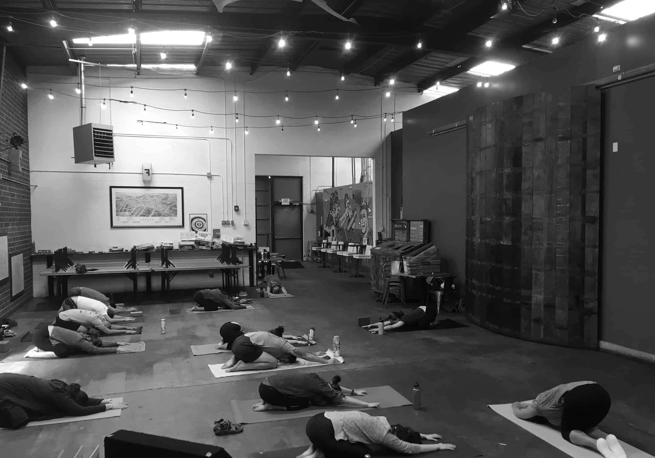 yoga class inside Fullsteam Brewing
