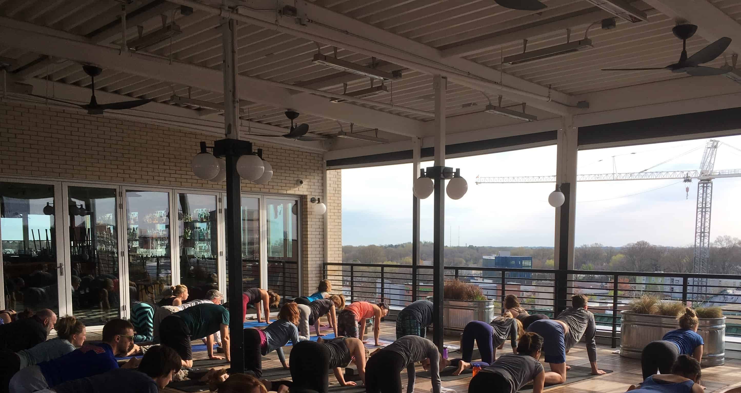 yoga workout on the rooftop of the Durham Hotel