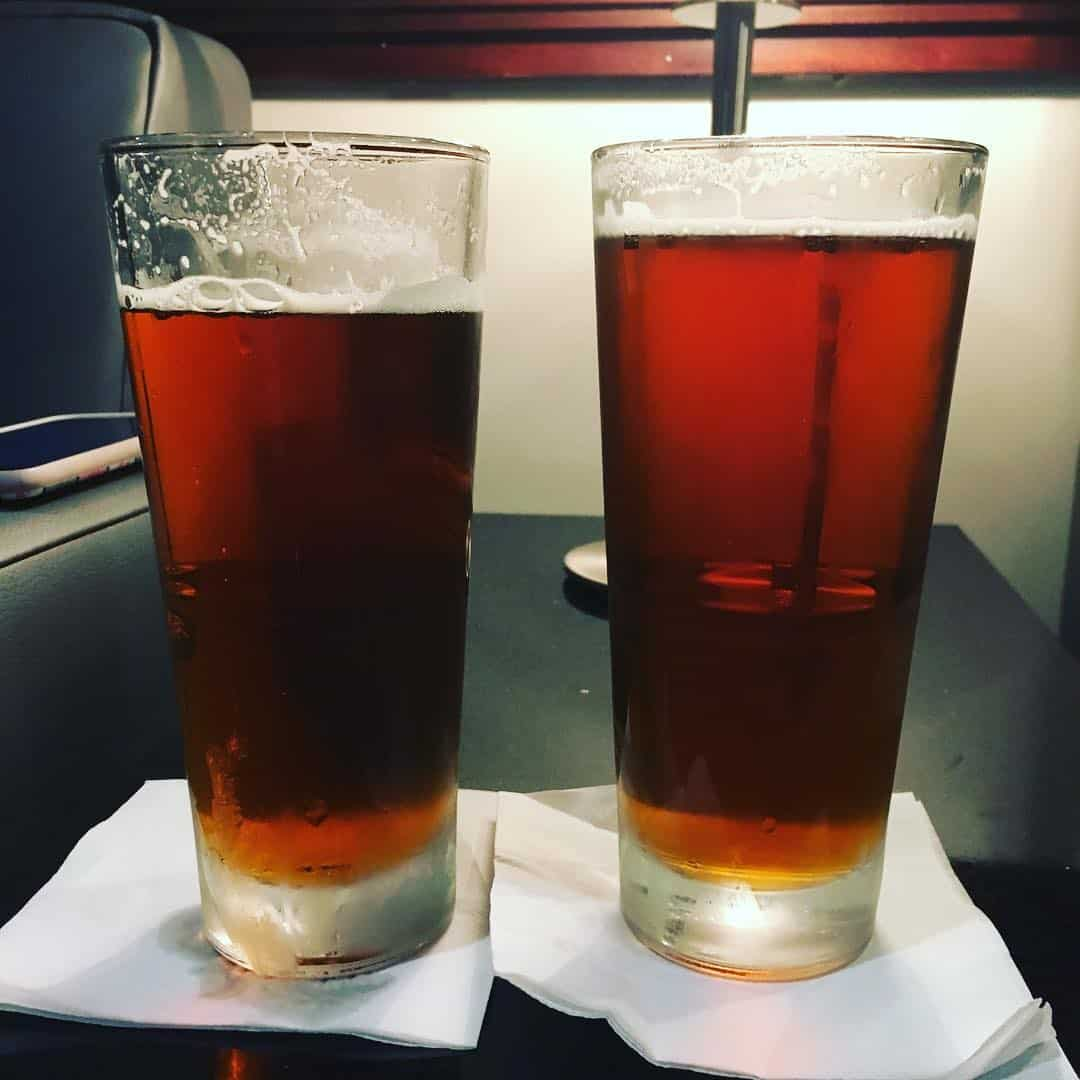 The Ultimate Weekend in Charlotte NC featured by top travel blog, The Common Traveler: Charlotte Two pint glasses with reddish draught beer.