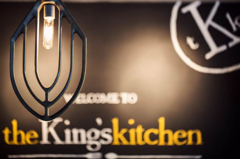 The Ultimate Weekend in Charlotte NC featured by top travel blog, The Common Traveler: Charlotte sign with Welcome to the King's Kitchen with light in front