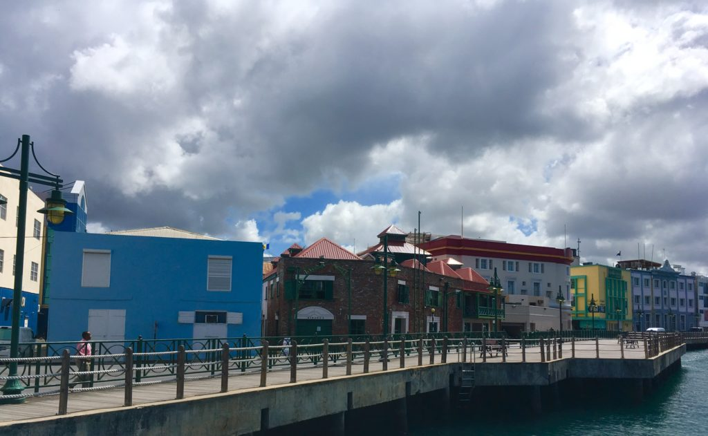 Unique Things to Do in Barbados on a Port Day featured by top US cruise blog, The Common Traveler: colorful buildings in Bridgeport, Barbados