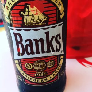 Unique Things to Do in Barbados on a Port Day featured by top US cruise blog, The Common Traveler: barbados bottle of Banks beer