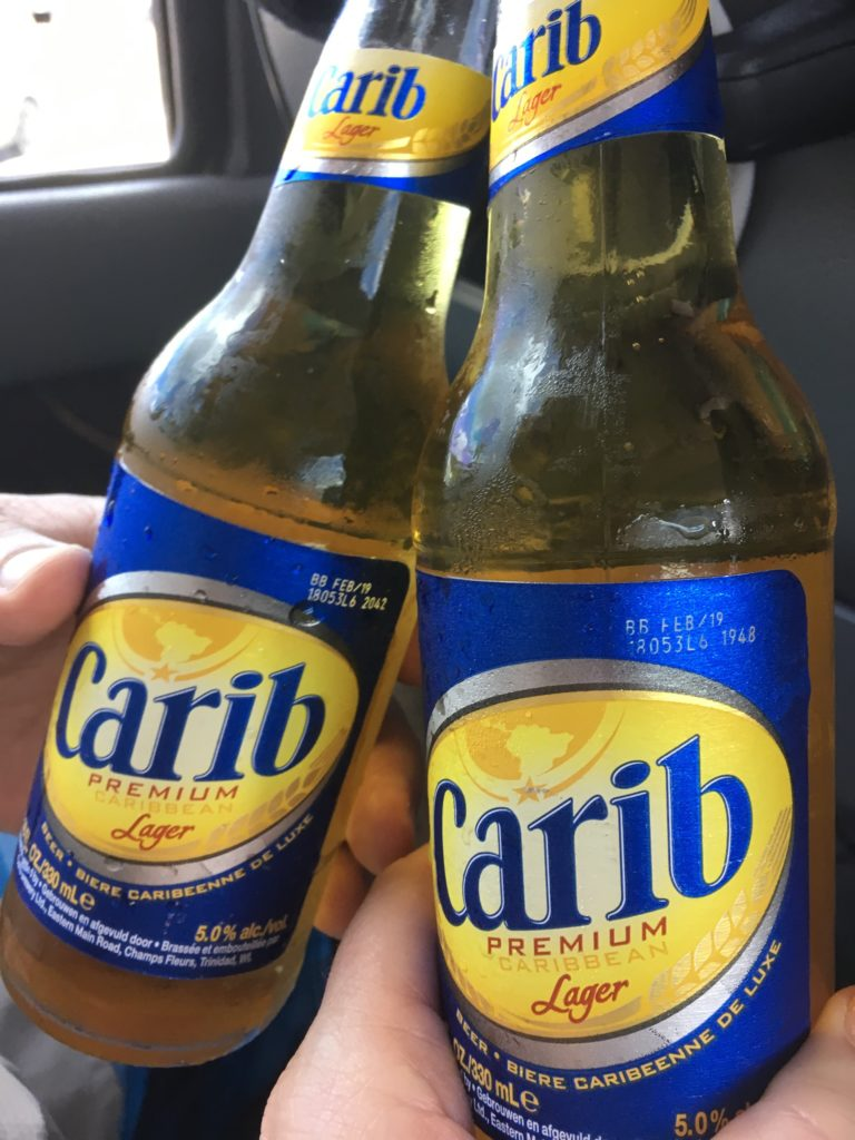 The Best Things to Do in St Kitts During a Port Day featured by top travel blog, The Common Traveler: two bottles of Carib beer
