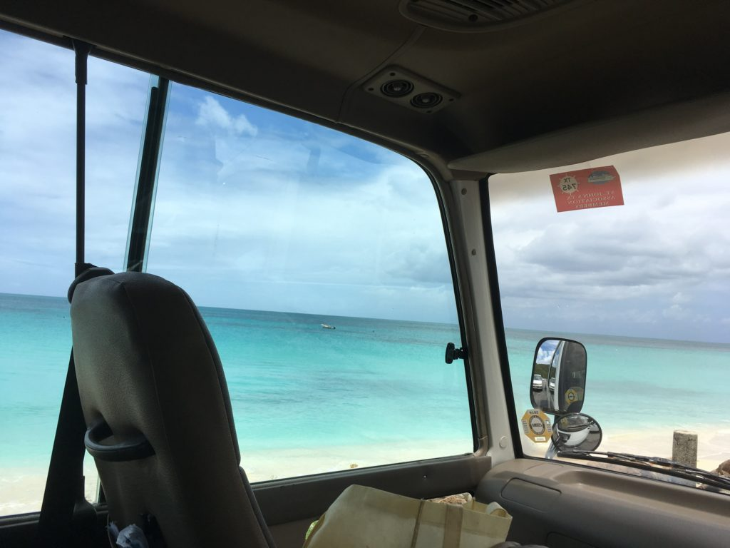 How to Enjoy Antigua  Beaches on a cruise port day, tips featured by top US travel blog, The Common Traveler: Antigua view from taxi window to beach