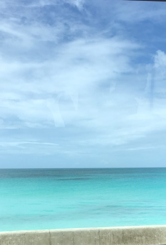 How to Enjoy Antigua  Beaches on a cruise port day, tips featured by top US travel blog, The Common Traveler: blue ocean and beach in Antigua