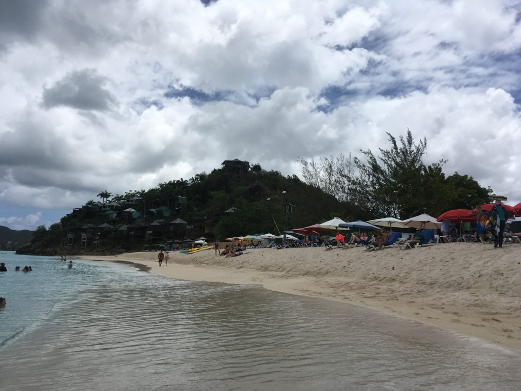Southern Caribbean Cruise 7 Day Itinerary featured by top travel blog, The Common Traveler:  Cruise beach with mountains in back, Antigua