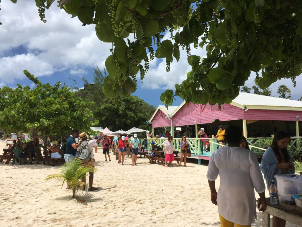 How to Enjoy Antigua  Beaches on a cruise port day, tips featured by top US travel blog, The Common Traveler: Antigua restaurant and people on beach