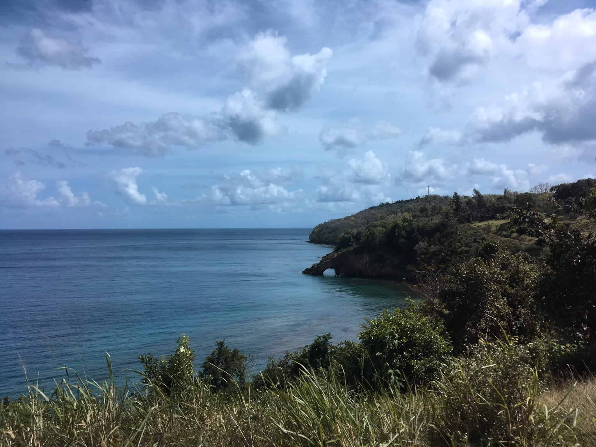 St. Lucia ocean with point jutting out forming a passage