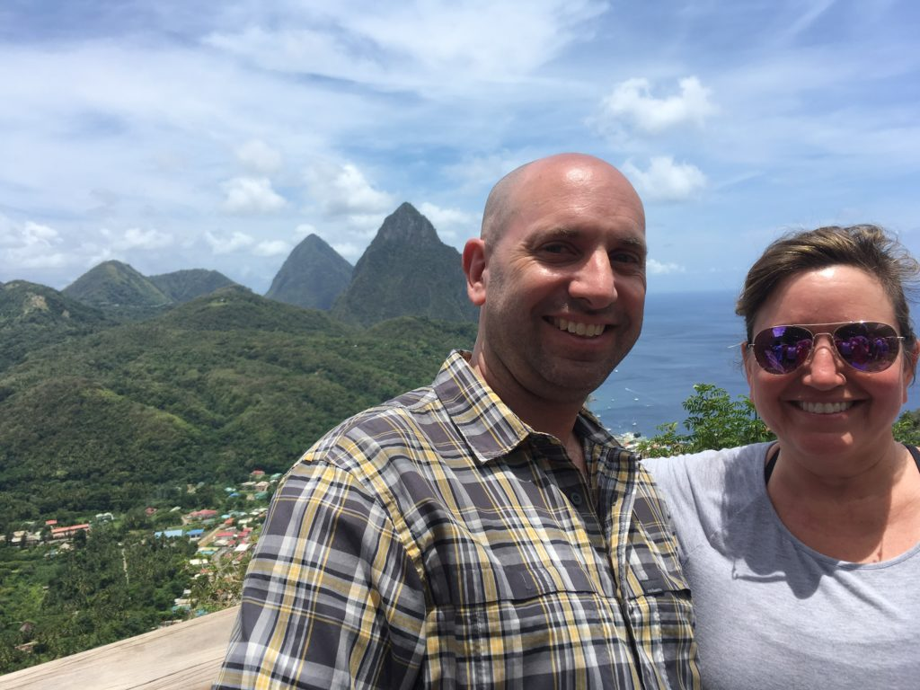 St. Lucia couple with Pitons in the background.