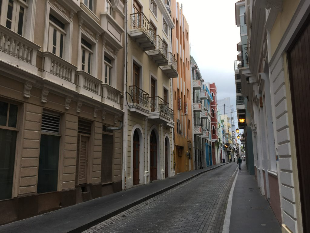 Old San Juan cobblestone street with colorful buildings