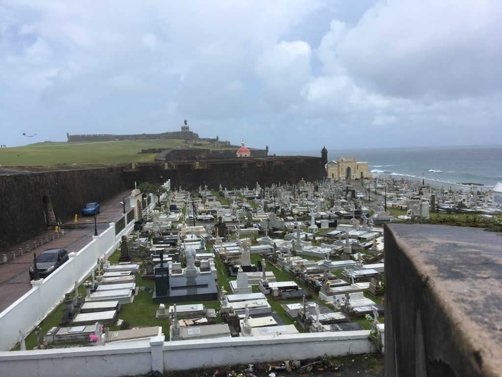 Old San Juan cemetery in foreground with old fort in background in san juan