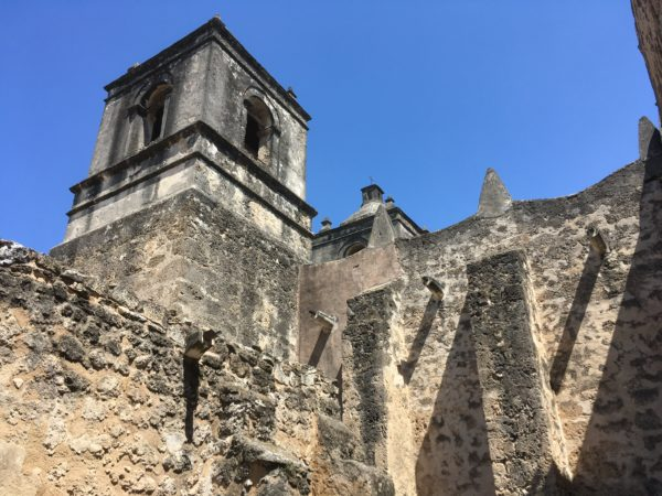 Tips for visiting San Antonio Missions shared by top US travel blog, The Common Traveler: stone walls with tower - Mission Concepcion San Antonio's Missions