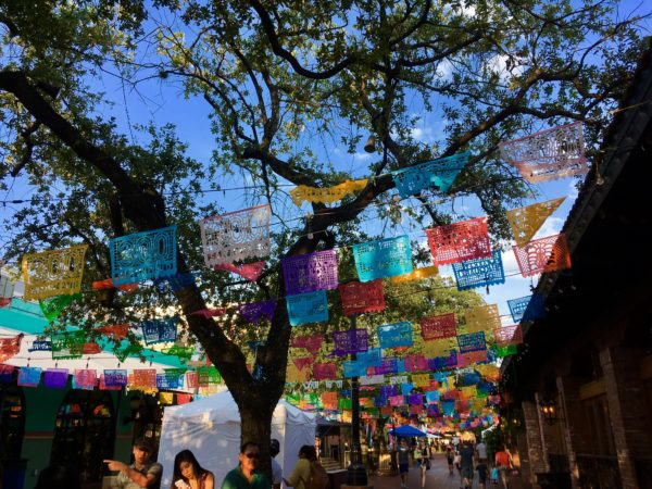 VIVA San Antonio Review featured by top travel blog, The Common Traveler: San Antonio colored flags over Market Square