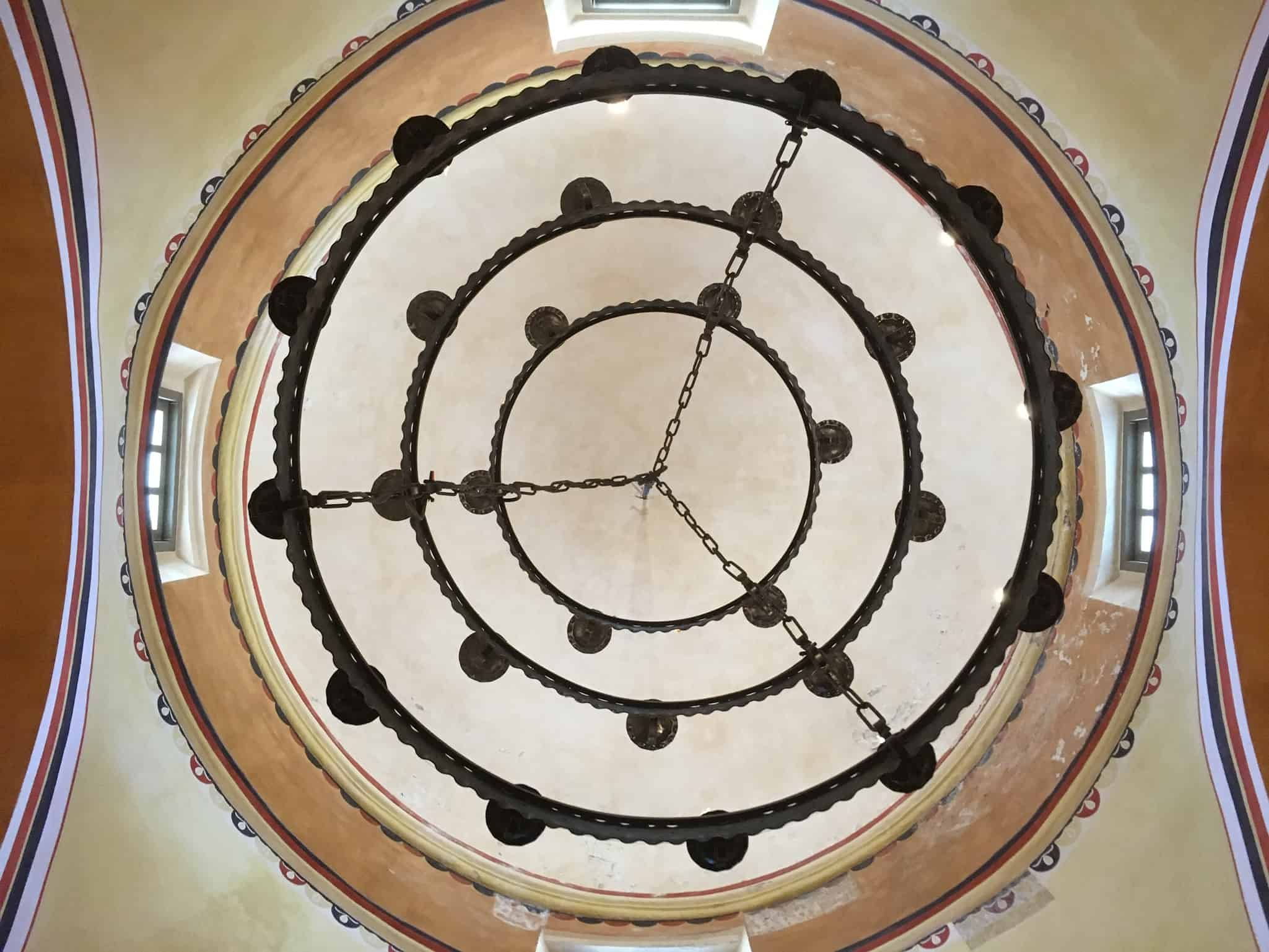 Tips for visiting San Antonio Missions shared by top US travel blog, The Common Traveler: circles in ceiling inside church San Antonio's Missions
