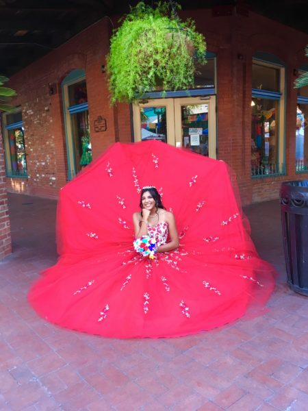 10 Things to Do and See in San Antonio for the weekend, a travel guide featured by top US travel blog, The Common Traveler: Quinceanera in red dress in San Antonio