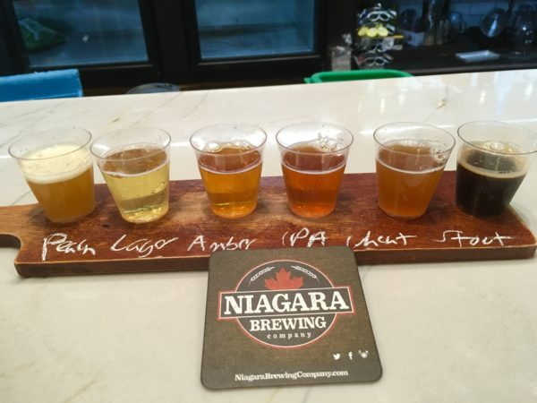 Day Trip to Niagara Falls - US and Canadian Sides featured by top travel blog, The Common Traveler: itinerary flight of beer at Niagara Brewing