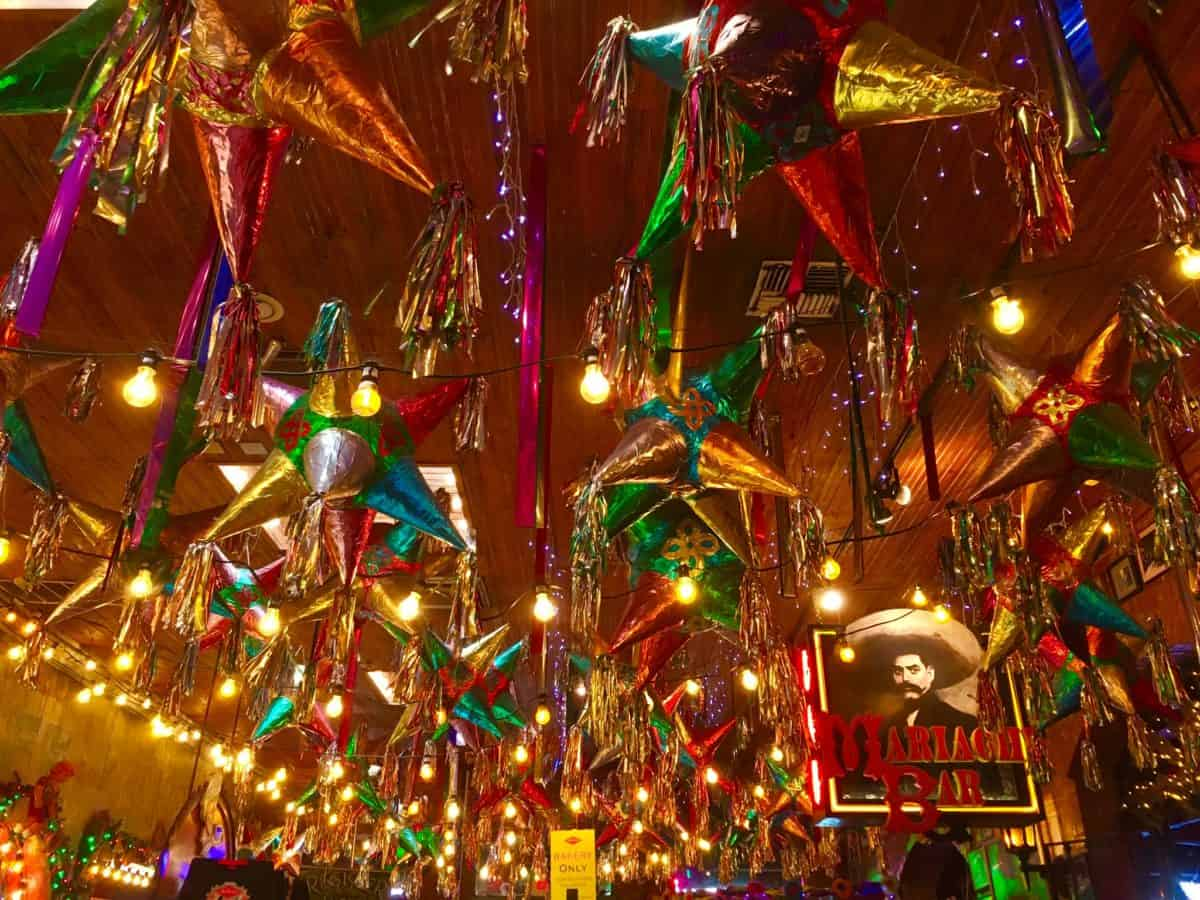 10 Things to Do and See in San Antonio for the weekend, a travel guide featured by top US travel blog, The Common Traveler: ceiling covered in colorful pinatas