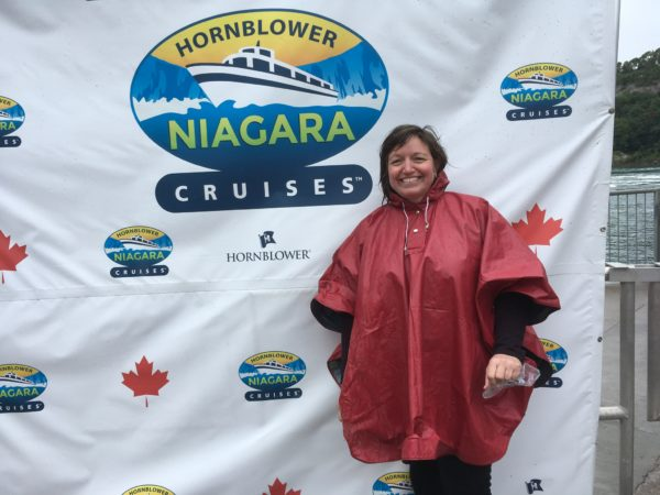 Day Trip to Niagara Falls - US and Canadian Sides featured by top travel blog, The Common Traveler: itinerary woman in front of sign with text