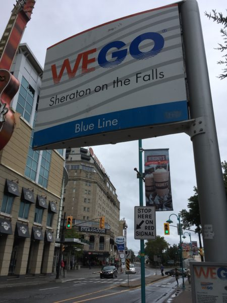 Day Trip to Niagara Falls - US and Canadian Sides featured by top travel blog, The Common Traveler: itinerary we go bus sign