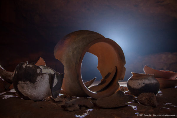 Visiting ATM Cave in Belize featured by top travel blog, The Common Traveler: Mayan clay pots with light in background - ATM Cave