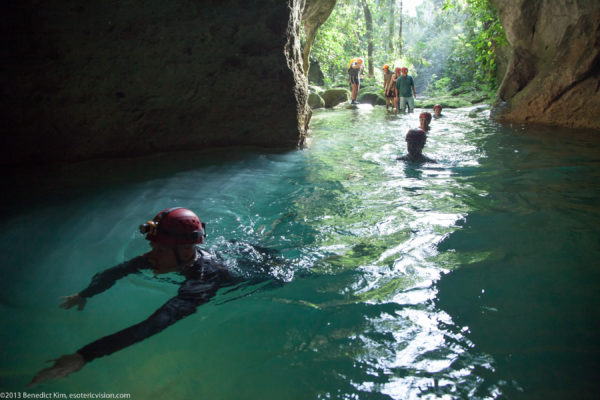 Visiting ATM Cave in Belize featured by top travel blog, The Common Traveler: people swimming into the ATM Cave in Belize