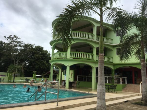 One Week in Belize featured by top US travel blog, The Common Traveler: green hotel with pool in Belize