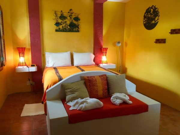 bed with red, orange, and yellow - tropical
