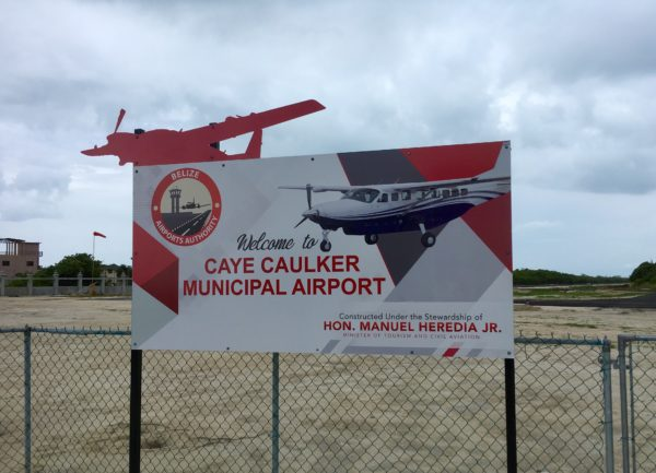 Best Things to Do in Caye Caulker featured by top US travel blog, The Common Traveler: airport sign in Caye Caulker