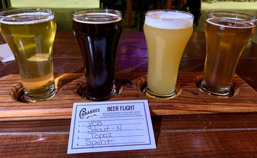 The best things to do in Concord NC in a weekend featured by top travel blog, The Common Traveler: flight of four beers from Cabarrus Brewing Company