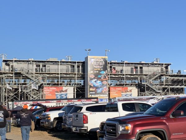metal building with parking lot in foreground - Grandstand at the Dirt Track in Concord, NC