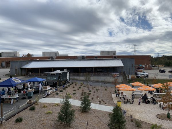 mill building home to Cabarrus Brewing Company with food trucks and beer garden