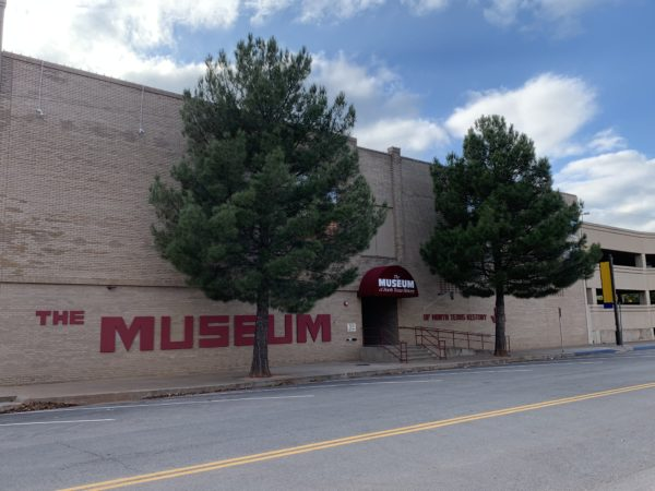 Wichita Falls Texas Itinerary featured by top travel blog, The Common Traveler: front of building with two trees for the Museum of North Texas History in Wichita Falls, Texas