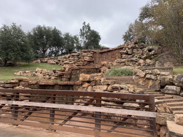 Wichita Falls Texas Itinerary featured by top travel blog, The Common Traveler: dried manmade falls using stones in Wichita Falls, Texas