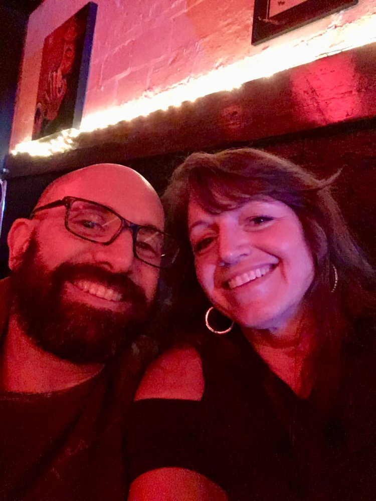 smiling couple in Red Room - bar with red light