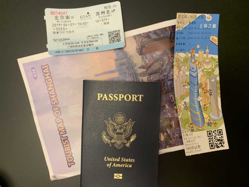 passport, map, tickets to Shanghai attractions