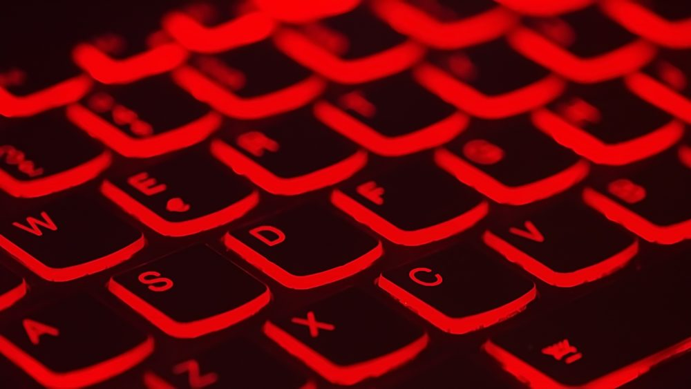 ExpressVPN review: the best VPN for travel. A Review featured by top travel blog, The Common Traveler: image of black keyboard keys illuminated by red background light