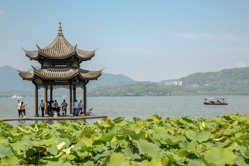 pagoda with West Lake in background, Hangzhou, China